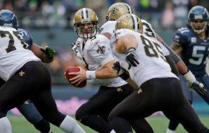 drew_brees_prepares_to_pass_vs_seahawks_in_2011_nfc_wildcard